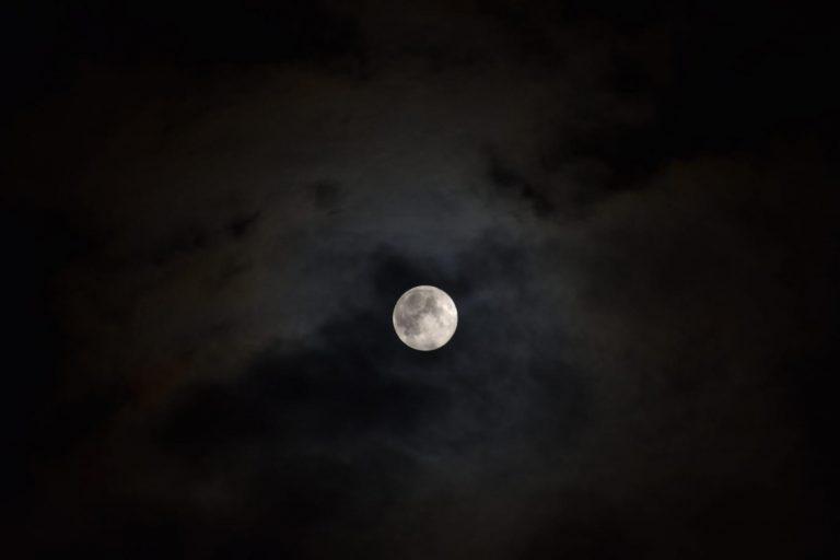 The full moon against a cloudy sky