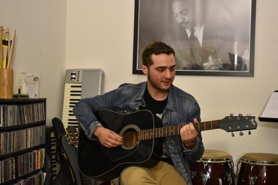 Jacobs pursues interest in music, writes, performs