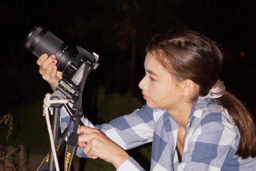 Amanda Tsai (12) sets up her camera to take photos of the stars at Hilltop Park, Sept. 27.
