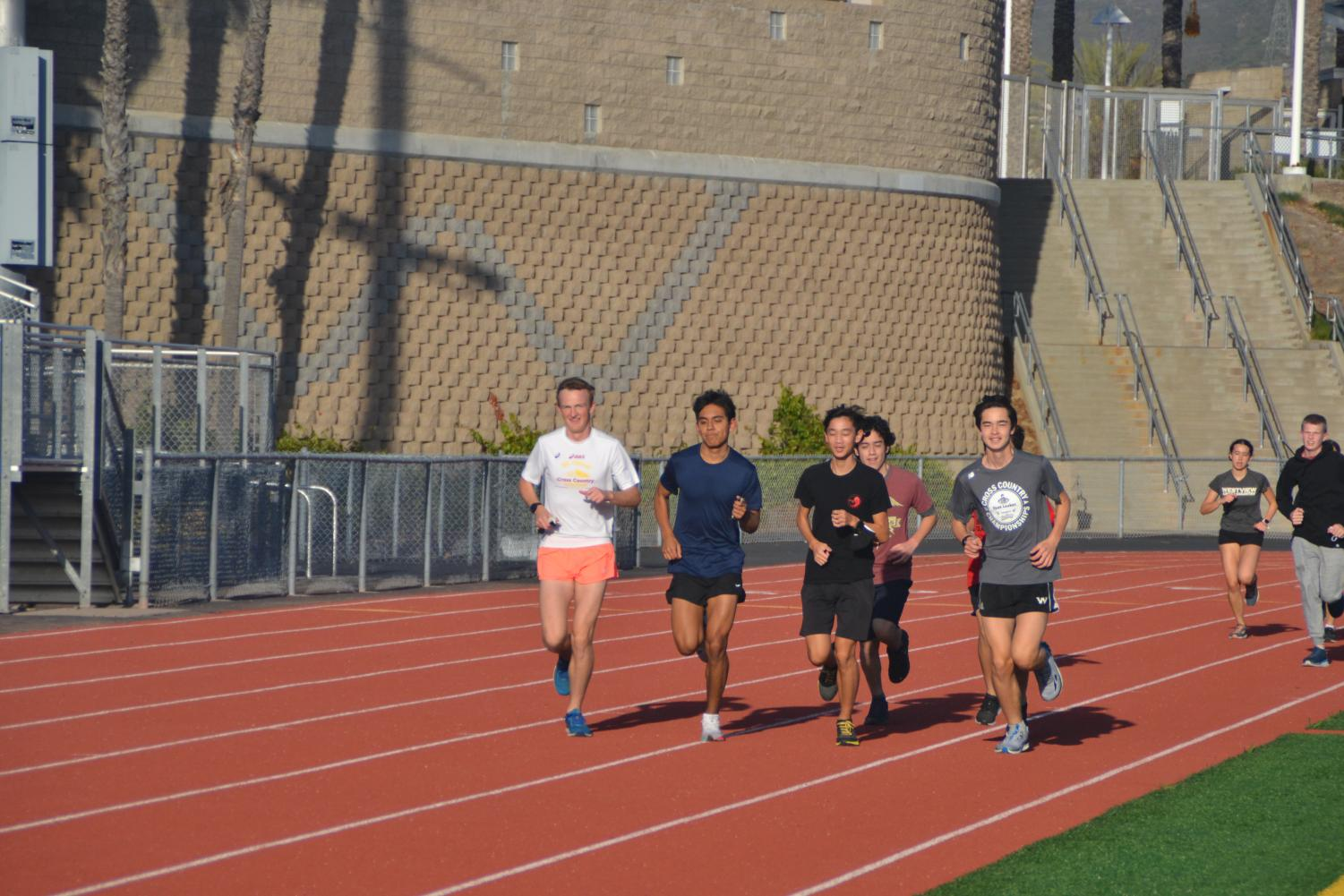 Drew Cottingham (12), Lara, Ho, and Nathan Leroy (11) lead the team around the track. Photo by Matthew Flores