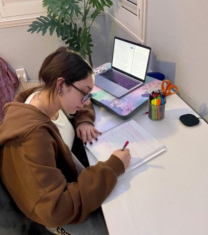 Olivia Dawson (11) takes notes using pen and paper, which is one of the strategies she uses to stay focused during online school. Photo courtesy of Olivia Dawson.
