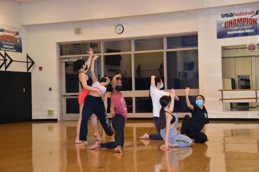 Dance Troupe members practice in the gym to prepare for a Spring Show.