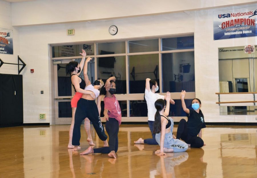 Dance Troupe members practice in the gym in preparation for a Spring Show. Photo by Alice Chen.