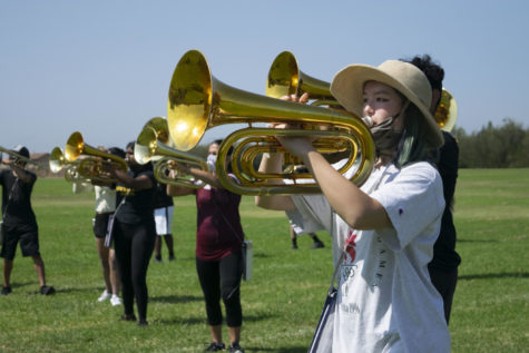 Band President Katie Jacques joins the trombone section during this practice. Other times, Jacques plays the oboe
