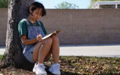 Grace He (11) listens to music while journaling her thoughts to de-stress. As a competitive figure skater, He grapples with the ex-ternal pressures of her sport