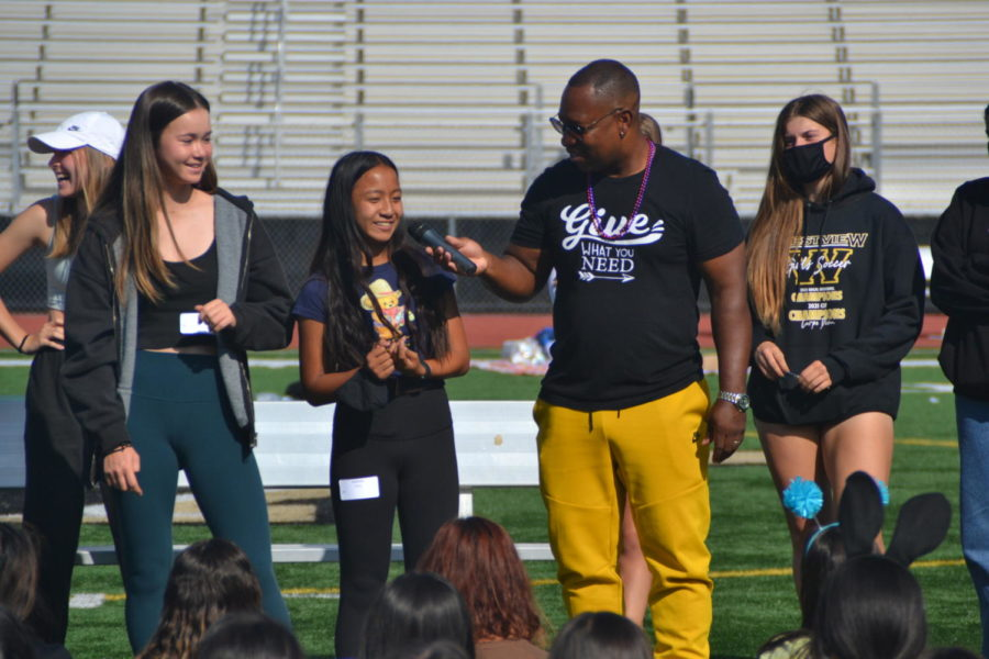 Keith Hawkins asks Bella Santos (11) when was the last time she told her best friend that she loved her. Hawkins asked questions like these to tie in with his message on connectedness and compassion during Unity Day. Photo by Matthew Flores