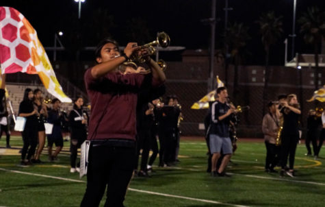 Carson Parel (11) preps his horn to play during a practice run of GOLDs show, Sept. 28. GOLD will compete at the Rancho Bernardo Field Tournament Saturday.