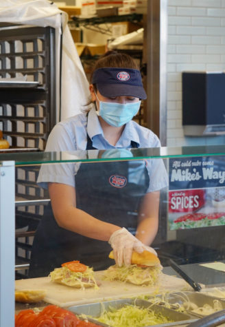 Lilah Nash (11) assembles a sandwich during her second-to-last shift, Oct. 5. After working at a sandwich shop for eight months, Nash quit to prioritize school work. Photo by Katie Lew.